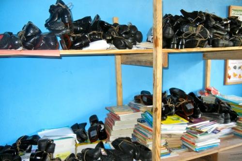 organizing the shoes on bookshelves