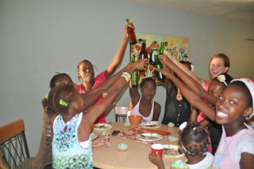 celebrating with the older girls who prepared the meal