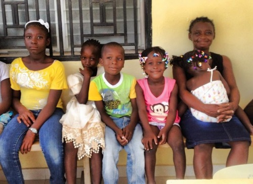Manese with her five children at school registration. All of them will be attending school this fall!